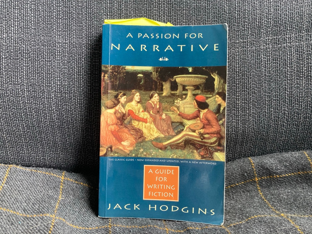 """A blue book on a gray background. The book is """"A Passion for Narrative: A Guide for Writing Fiction"""" by Jack Hodgins. There is a picutre of some women surrounding a man with a stringed instrument and they seem very interested in what he is saying. It looks like it coud be from the Renaissance, possibly."""